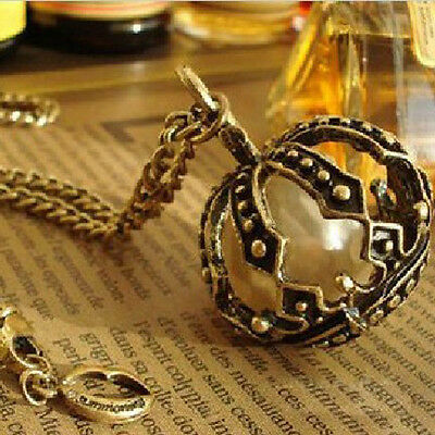 Free Fashion jewelry crown Bronze Retro long Pendant sweater Necklace N03