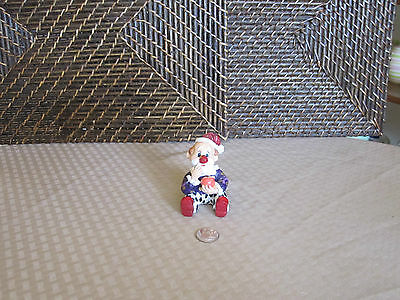 Clown miniature figurine sitting looking confused colorful design