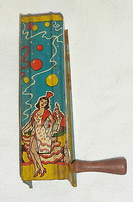 New Years Eve Noise Maker USA Metal Toy Show Girls Dancers Lithograph Tin Wood