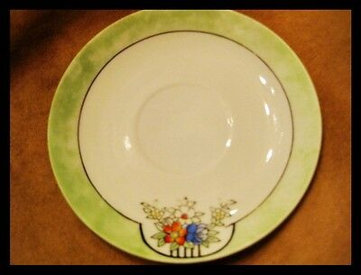 Beautiful vintage saucer Pale Green border with floral motif