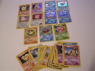OLD POKEMON CARDS 50 TOTAL INCLUDES 8 HOLOS AND 3 1ST EDITIONS