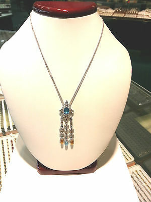 Adorable dangling Pendant with Gems and Diamonds 18K.