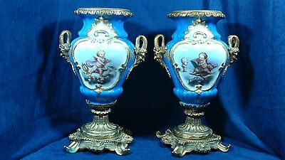 Sevres Style Pair of Urns Hand Painted Putty Ram Bronze Mount