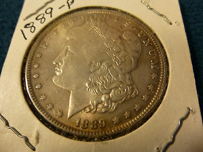 1889-p morgan silver dollar in fine to ex/ fine condition