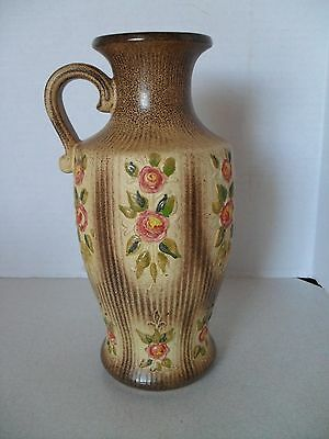 MID CENTURY WEST GERMANY ART POTTERY VASE WITH HANDLE AND FLOWERS