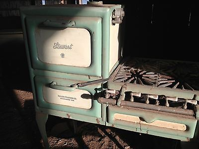 Antique Stewart oven. green and cream