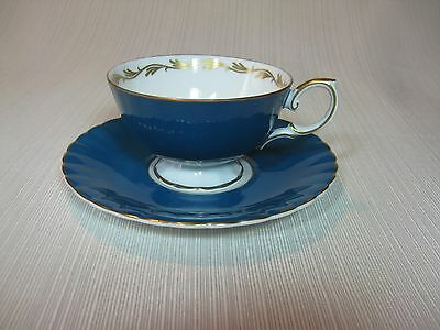 Susie Cooper Bone China Blue Tea Cup and Saucer Gold Highlights and Trim Roses