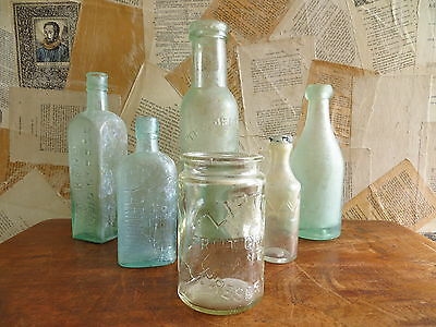 collection of 6 vintage shabby chic aqua glass bottles