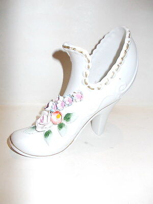 Bisque porcelain high heeled shoe vase with flowers