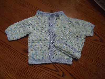 crocheted baby sweaters and accessories