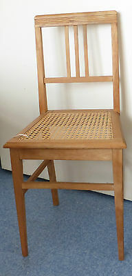 light wood chair with recaned seat