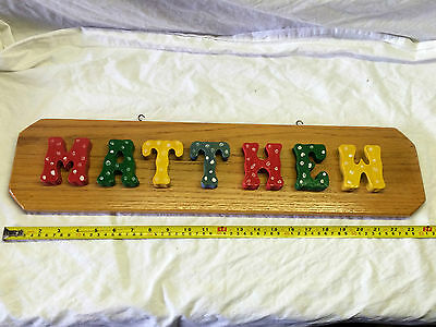 """Plaque with the name """"Mathew"""" in wood letters on wood  S#E8"""