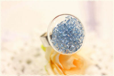 Anello in plexiglass con strass a diamante azzurro base in metello regolabile