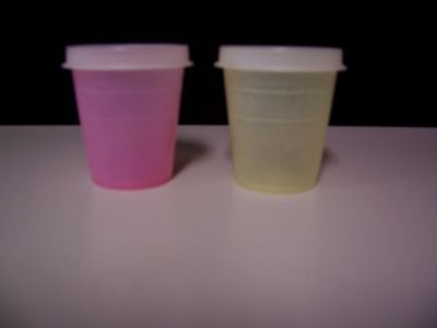 Tupperware Made IN USA Set of Two 2 oz Midgets With Lids Pink and Yellow