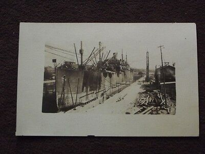 LARGE COMMERCIAL  SHIP OR FREIGHTER IN DRY DOCK 1910's  REAL PHOTO POSTCARD