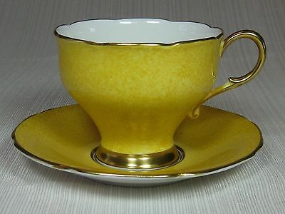 Paragon Mottled Yellow Cup & Saucer Gold Trim by Appointment to H.M. Queen Mary