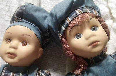 """Set of 2 12"""" Porcelain boy and girl dolls with matching blue plaid jumpers"""