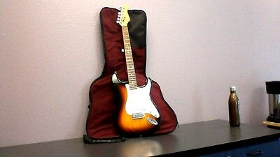 Electric Guitar with 2X2 amp,case, cords,tuner and picks.