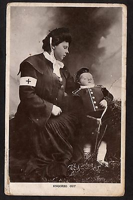 Posted C1910 - Lady & Boy in Kilt/ Soldiers Uniform 'Knocked Out'