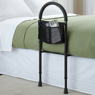 Safety bed rail mobility aid guard adjustable in height with storage pocket