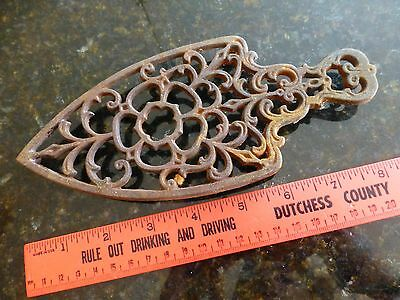 "vintage cast iron trivet 8x3 1/2"" antique 1952 JZH flower swirls"