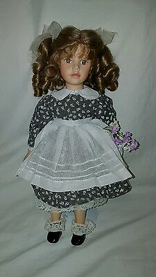Cute porcelain doll with purple flowers on stand collectable