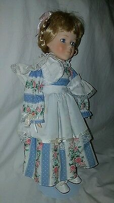 Blonde porcelain doll with stand