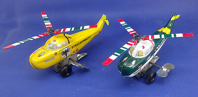 lot of 2 wind-up tin helicopters  made in JAPAN  new 1960's!