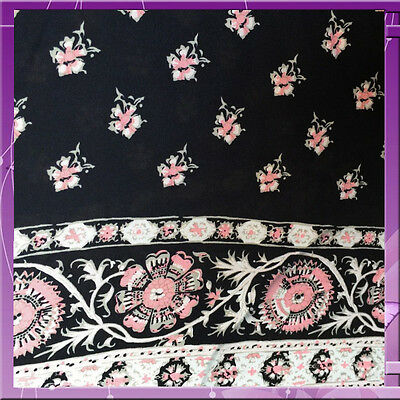 100% Rayon. Dainty pink flowers n bordered Navy blue background