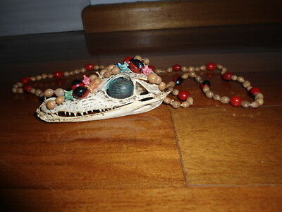 Antique tribal necklace skull tooth taxidermy.