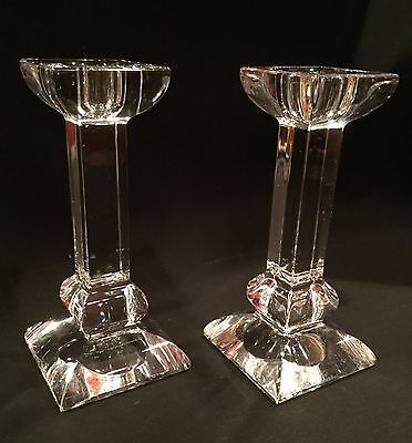 Pair of heavy crystal glass candlestick holders.  Modern design.