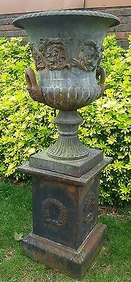 LARGE VINTAGE CAST IRON URN ON PLINTHS.(not reproduction)