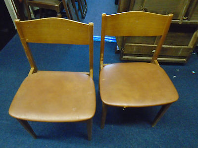2 wood and leather seated chairs.