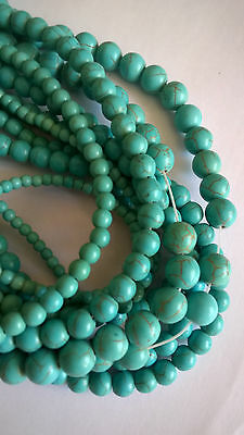 "Turquoise  beads 15""strand,10-4mmmm in diam"