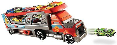 HOT WHEELS Blastin' Rig Vehicle SHOOTS CARS includes 3 cars STORES UP TO 14 CARS