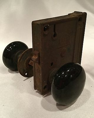 Antique door knob with plate and lock.  No key!