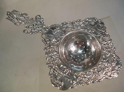 Antique Silver (HM) Tea Strainer. Dutch Figurative Silver Tea Strainer .(890)