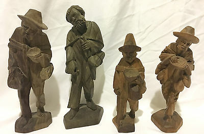 Four Antique Hand Carved Solid Wood Figurines Made in Ecuador.