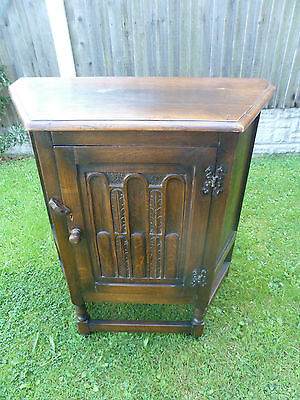 Vintage Wood Brothers old charm Tudor oak cabinet with single shelf