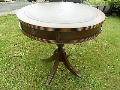Vintage Regency revival drum table with tooled leather skiver and drawers