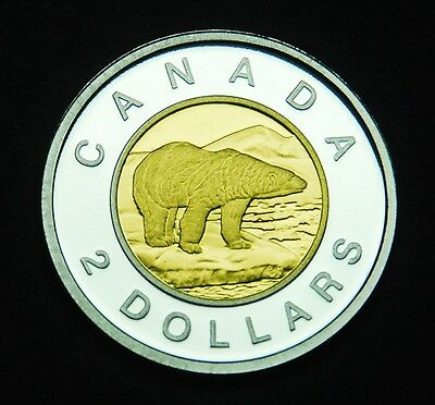 "2012 two dollar .9999 silver ""toonie"" with gold-plated core. Ultra cameo BU coin"
