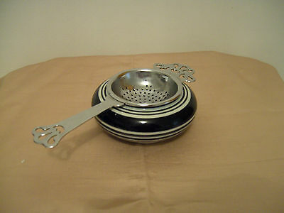 A Vintage Chrome Plated Tea Strainer And China Bowl - Holland