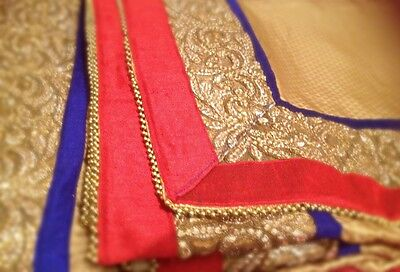 Gold Shimmering Saree With Royal Blue, Red & Gold Big Border Heavy Party Wear