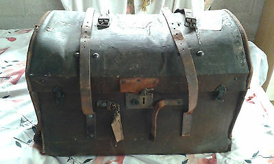 Antique dome-topped travelling trunk with interior tray and fittings