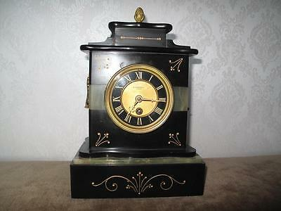 A Victorian Black Marble 8 Day Mantle Clock