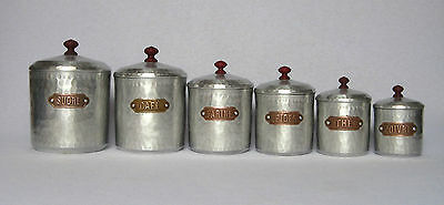 COMPLETE SET OF 6 VINTAGE FRENCH ALUMINUM CANISTERS, with dimpled bodies