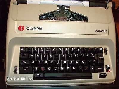 """Olympia """"reporter"""" Electric Portable typewriter  w/hard case"""