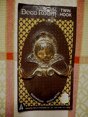Vintage early 1970's NEW OLD STOCK TWIN HOOK HARDWARE with sleeping girl. Sealed