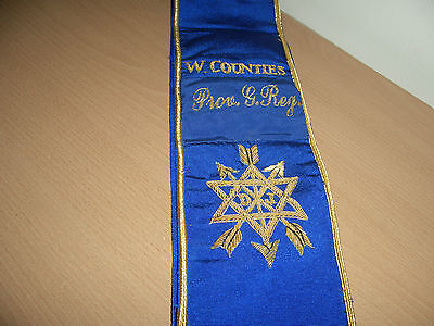 A Masonic sash in bright blue with gilt stitching