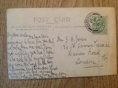 Postcard Child in garden seat  postmark 1907 Maesteg Bridgend